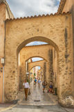 Unidentified  poople walking in street, Architecture of Saint Tropez city in French Riviera, France. Saint Tropez, France - September 5, 2016: unidentified Royalty Free Stock Photo