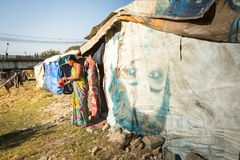 Unidentified poor people near their houses at slums in Tripureshwor district, Kathmandu. Stock Photography