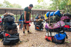 Unidentified porters carry climbers belongings Royalty Free Stock Image