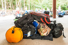 Unidentified porters carry climbers belongings Royalty Free Stock Photography