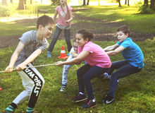 Unidentified preteen kids play rope pull game Royalty Free Stock Photos