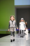 Unidentified pretty child models walk the catwalk. MOSCOW - FEBRUARY 22: Unidentified pretty child models wear fashions by Snowimage and walk the catwalk in the Stock Photography