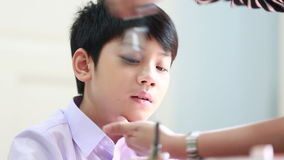 Unidentified professional make up artist ,Make up asian child before the photoshoot.  stock footage