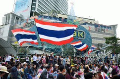 Unidentified protesters gather Patumwan intersection to anti government and ask to reform before election. BANGKOK-JAN 22 : Unidentified protesters gather Stock Photos