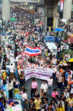 Unidentified protesters gather Patumwan intersection to anti government and ask to reform before election. BANGKOK - JAN 26 : Unidentified protesters gather Stock Photos