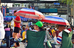 Unidentified protesters gather Ratchaprasong Intersection to anti government and ask to reform before election Royalty Free Stock Photo