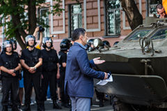 Unidentified protestor trys to stop provocation - moving of  arm. Ored military vehicle in  Rise up, Ukraine! demonstration in Kiev, Ukraine on May 18, 2013 Stock Photos
