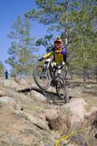 Unidentified racer looked into the camera in a jump on the competition for the Cup of Buryatia on a Mountain Bike Stock Photos