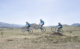 Unidentified racer overcomes the jump on the competition for the Cup of Buryatia on a Mountain Bike. Ulan-Ude, Russia - April 27: unidentified racer overcomes Royalty Free Stock Image