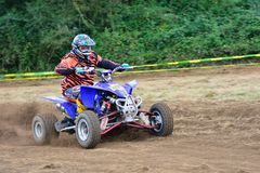 Unidentified racer rides a quad motorbike. Royalty Free Stock Photos