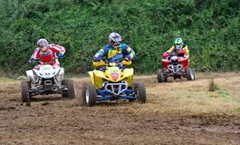 Unidentified racer rides a quad motorbike. Stock Photo