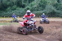 Unidentified racer rides a quad motorbike. Stock Photos