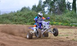 Unidentified racer rides a quad motorbike. Royalty Free Stock Image