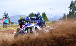 Unidentified racer rides a quad motorbike. Stock Images