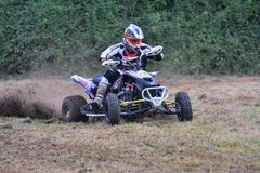 Unidentified racer rides a quad motorbike. Royalty Free Stock Photography