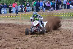 Unidentified racer rides a quad motorbike. Royalty Free Stock Images