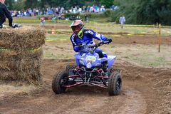 Unidentified racer rides a quad motorbike. Royalty Free Stock Photo
