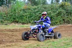 Unidentified racer rides a quad motorbike. Stock Image