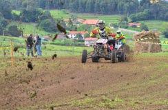 Unidentified racer rides a quad motorbike. Stock Photos