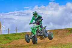 Unidentified racer rides a quad motorbike. Stock Photography