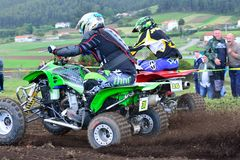 Unidentified racers rides a quad motorbike. Royalty Free Stock Images