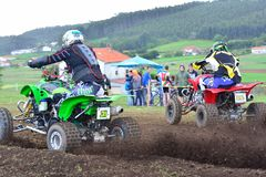 Unidentified racers rides a quad motorbike. Stock Images