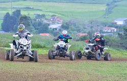 Unidentified racers rides a quad motorbike. Stock Photography