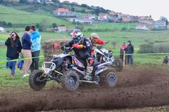 Unidentified racers rides a quad motorbike. Stock Photo