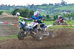 Unidentified racers rides a quad motorbike. Stock Photos
