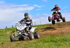 Unidentified racers rides a quad motorbike. Royalty Free Stock Image