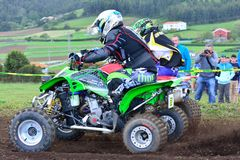 Unidentified racers rides a quad motorbike. Royalty Free Stock Photography
