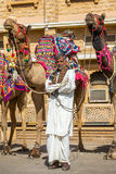 Unidentified rajasthani man with camels Royalty Free Stock Image
