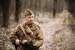 Unidentified re-enactor dressed as Russian Soviet soldier in camouflage walk Stock Photography