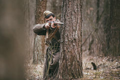 Unidentified re-enactor dressed as Soviet russian soldier aiming Royalty Free Stock Photo