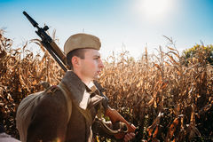 Unidentified re-enactor dressed as Soviet russian soldier goes a Royalty Free Stock Photography