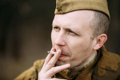 Unidentified re-enactor dressed as Soviet soldier Stock Photos