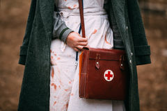 Unidentified re-enactor wears historical German. PRIBOR, BELARUS - April 05, 2015: Unidentified re-enactor wears historical German Red Cross - Deutsches Rotes Royalty Free Stock Photography