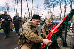 Unidentified Re-enactors Dressed As Russian Soviet Infantry Soldiers Of World War II Laying A Wreath At Common Grave. Pribor, Belarus - April 23, 2016 Royalty Free Stock Photography