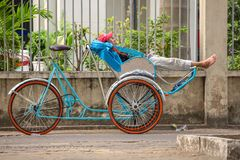 An unidentified rickshaw driver waits for clients Royalty Free Stock Images