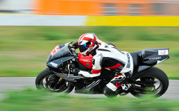 An unidentified rider. BUCHAREST, ROMANIA - OCTOBER 04: An unidentified rider participates in the Romanian Superbike Championship on October o4, 2015 at Adancata Stock Photos