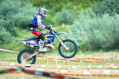 An unidentified rider. BUZAU, ROMANIA - JUNE 15: An unidentified rider participates in the World Endurocross Championship on June 15, 2013 at Maracineni, in Royalty Free Stock Image