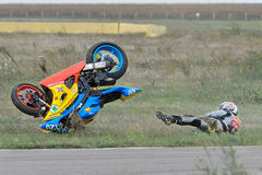 An unidentified rider fell on track. BUCHAREST, ROMANIA - SEP 27: An unidentified rider fell on track in the Romanian Championship Motorcycle Speed on Sep 27 Royalty Free Stock Photo