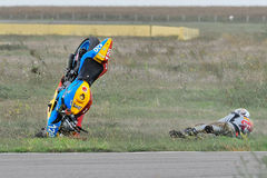 An unidentified rider fell on track. BUCHAREST, ROMANIA - SEPTEMBER 27: An unidentified rider fell on track in the Romanian Championship Motorcycle Speed on Royalty Free Stock Photos