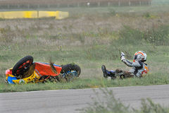 An unidentified rider fell on track in the Romanian Championship Motorcycle Speed. BUCHAREST, ROMANIA - SEP 27: An unidentified rider fell on track in the Stock Photo