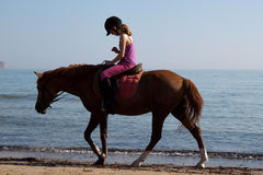 Unidentified rider on a horse on the beach Royalty Free Stock Images