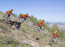 An unidentified rider jumps from a ramp on the competitions for the Cup of Buryatia on a Mountain Bike Royalty Free Stock Photography