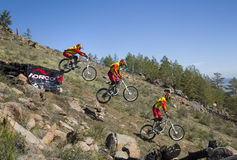 An unidentified rider jumps from a ramp on the competitions for the Cup of Buryatia on a Mountain Bike Stock Image