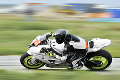 An unidentified rider on track in the Romanian Championship Motorcycle Speed. BUCHAREST, ROMANIA - SEP 27: An unidentified rider on track in the Romanian Royalty Free Stock Images