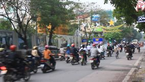 Unidentified riders ride motorbikes on busy road stock video footage