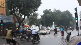 Unidentified riders ride motorbikes on busy road stock footage